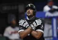 FILE - In this July 28, 2020, file photo, Chicago White Sox's Jose Abreu looks up after hitting a solo home run in the sixth inning in the second baseball game of the team's doubleheader against the Cleveland Indians in Cleveland. Abreu won the AL MVP prize Thursday, Nov. 12, a reward for powering his team back into the playoffs for the first time since 2008. (AP Photo/Tony Dejak, File)