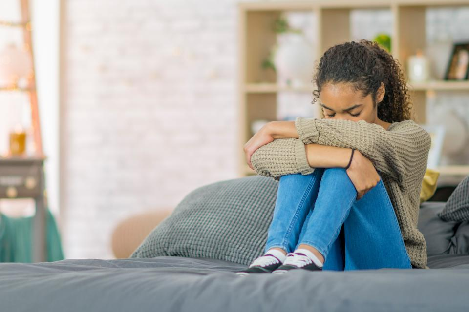 Children can struggle with their emotions when grieving the loss of a loved one. (Getty Images)