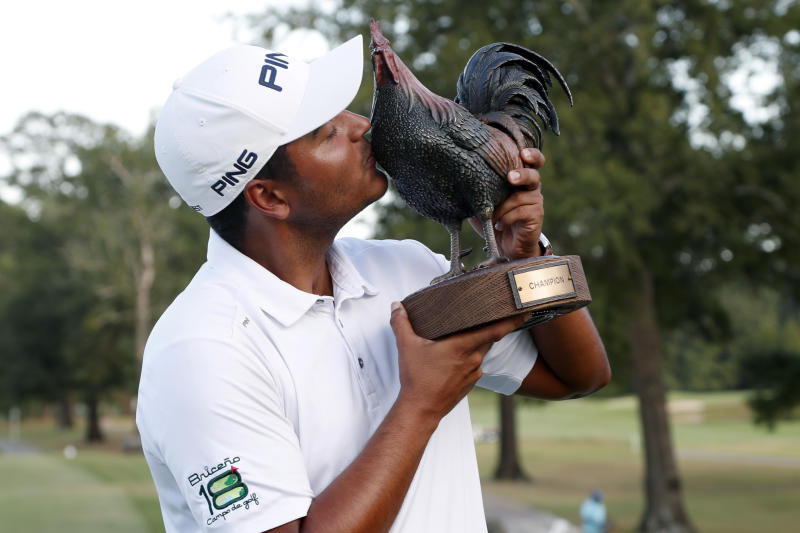Sebastian Munoz, of Colombia, kisses the trophy after winning the Sanderson Farms Championship golf tournament in Jackson, Miss., Sunday, Sept. 22, 2019. (AP Photo/Rogelio V. Solis)