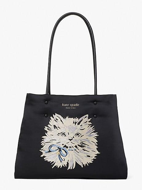 <p><span>Everything Puffy Cat Large Tote</span> ($258)</p>