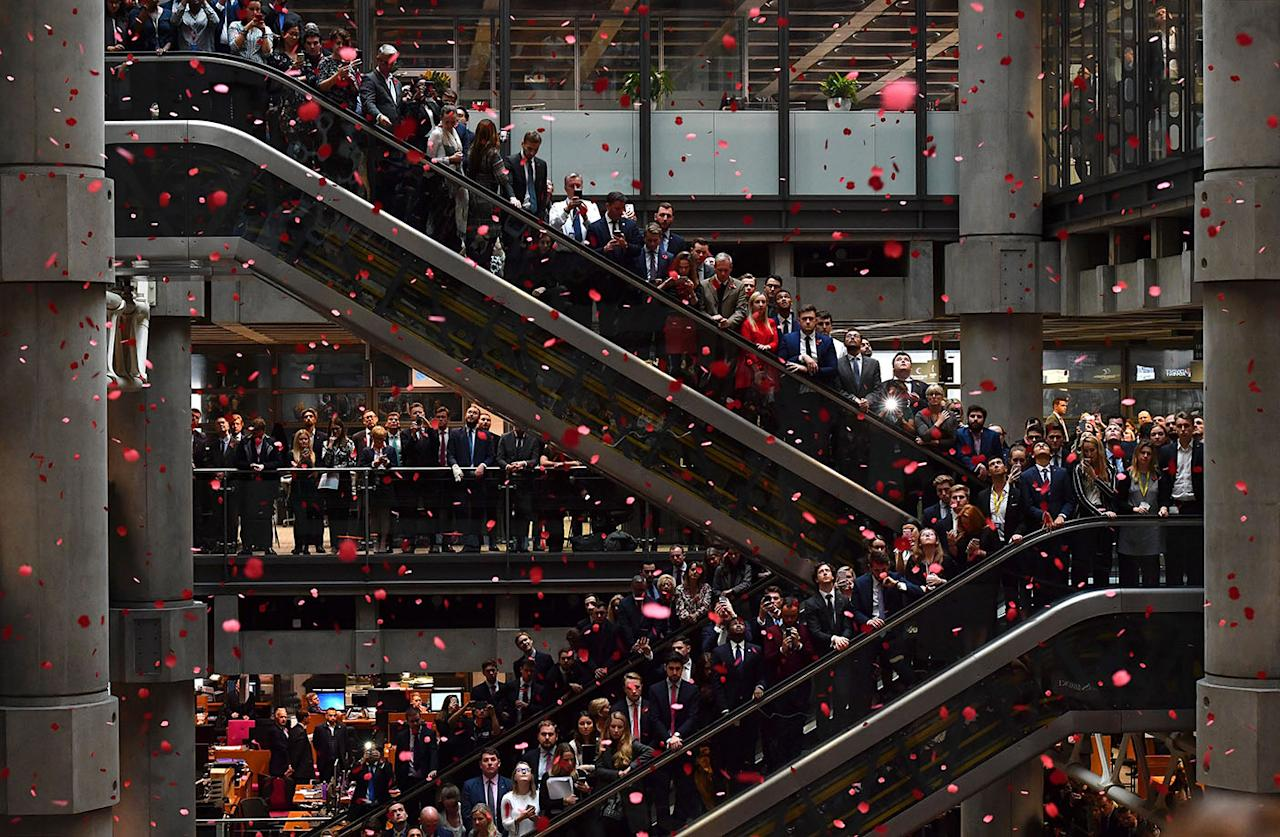 <p>Red poppies fall from above as employees observe a minute's silence in commemoration of Remembrance Day, inside Lloyd's of London in the city of London on Nov. 9, 2018. – Nov. 11, 2018 is the 100th anniversary of the end of WWI. In the run-up to Armistice Day, many Britons wear a paper red poppy — symbolising the poppies which grew on French and Belgian battlefields during World War I. (Photo from Ben Stansall/AFP/Getty Images) </p>