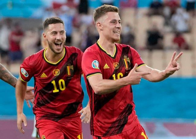 Thorgan Hazard, right, celebrates with his brother Eden after opening the scoring for Belgium against Portugal