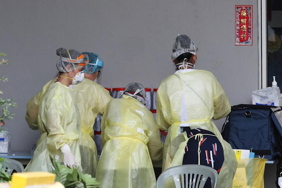SINGAPORE - APRIL 27: Healthcare workers wearing personal protective equipment are seen in the compound of a factory-converted dormitory  on April 27, 2020 in Singapore. Singapore is now battling to control a huge outbreak in the coronavirus (COVID-19) local transmission cases among the migrant workers.  (Photo by Suhaimi Abdullah/Getty Images)
