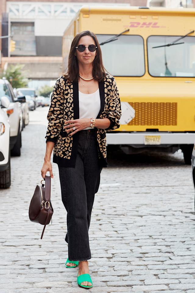 <p>Make a neutral cardigan and jeans look stand out with a vibrant pair of shoes like Dana's bright-green mules. </p>