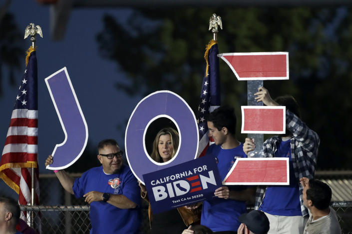 Supporters wait for a campaign rally for former Vice President Joe Biden on March 3, 2020, in Los Angeles. (Marcio Jose Sanchez/AP)