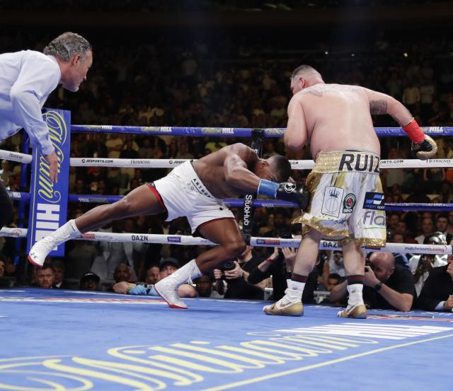 Andy Ruiz, right, knocks down Anthony Joshua during the seventh round of a heavyweight championship boxing match Saturday, June 1, 2019, in New York. Ruiz won in the seventh round. (AP Photo/Frank Franklin II)