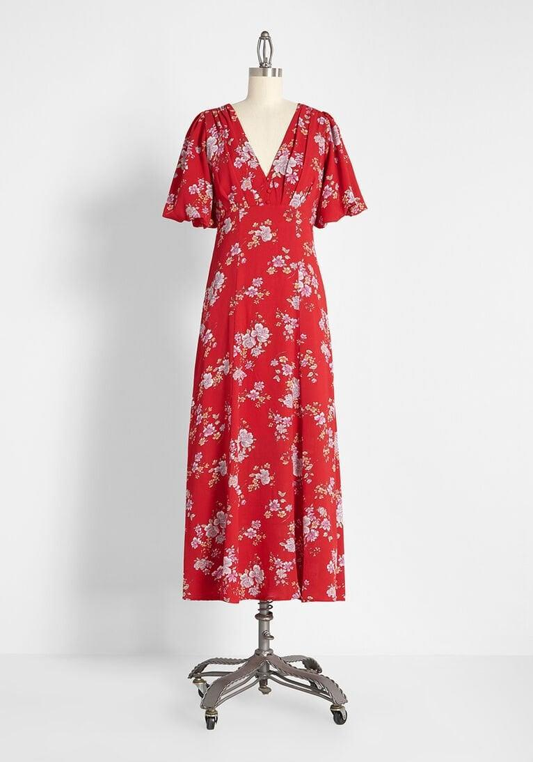 <p>The cut of this <span>Floral at Its Finest Midi Dress</span> ($139) is flattering.</p>