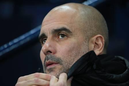 86048833_Manchester City's Spanish manager Pep Guardiola awaits kick off in the English Premier.jpg