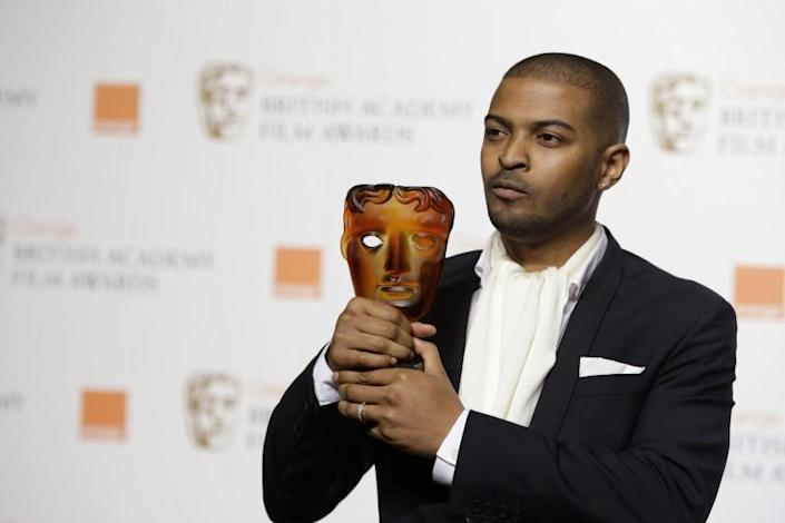 FILE - In this Sunday, Feb. 8, 2009 file photo, British actor and director Noel Clarke, displays his Orange Rising Star Award at the British Academy Film Awards 2009 at The Royal Opera House in London, England. Britain's motion picture academy on Thursday April 29, 2021, suspended actor-director Noel Clarke after a newspaper reported that multiple women had accused him of sexual harassment or bullying. (AP Photo/Joel Ryan, File)