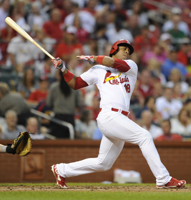 St. Louis Cardinals' Oscar Taveras (18) follows through on his RBI single against the Boston Red Sox in the first inning in a baseball game, Thursday, August 7, 2014, at Busch Stadium in St. Louis. (AP Photo/Bill Boyce)