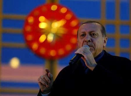 Turkish President Tayyip Erdogan addresses his supporters at the Presidential Palace in Ankara
