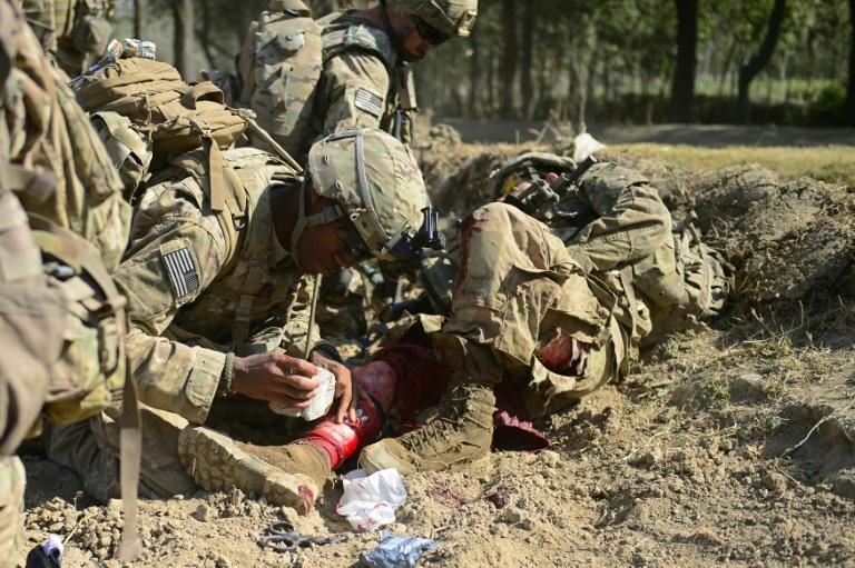 The use of body armor to protect against blast injuries has led Western and Afghan armies to teach first aid for head and extremity wounds