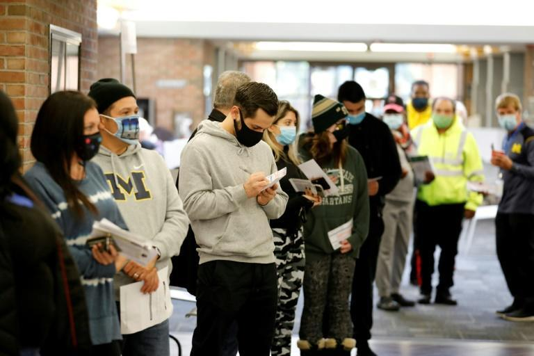 Voters line up to cast early ballots in West Bloomfield, Michigan
