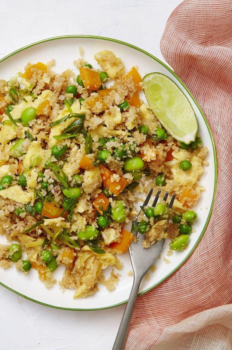 "<p>No need to use traditional rice when making this cauliflower-centric dish. Mix in your favorite veggies, such as peas and carrots, and add in scrambled egg for extra protein. Viola! You'll have a delicious vegetarian meal in no time. </p><p><a href=""https://www.womansday.com/food-recipes/food-drinks/recipes/a58137/cauliflower-fried-rice-recipe/?visibilityoverride"" rel=""nofollow noopener"" target=""_blank"" data-ylk=""slk:Get the Cauliflower Fried Rice recipe."" class=""link rapid-noclick-resp""><strong><em>Get the Cauliflower Fried Rice recipe. </em></strong> </a></p><p><a class=""link rapid-noclick-resp"" href=""https://www.amazon.com/Pre-Seasoned-Carbon-Steel-Wok-Pan/dp/B07VJ5LGJ9/ref=sr_1_7?dchild=1&keywords=WOK&qid=1610038896&sr=8-7&tag=syn-yahoo-20&ascsubtag=%5Bartid%7C10070.g.35142478%5Bsrc%7Cyahoo-us"" rel=""nofollow noopener"" target=""_blank"" data-ylk=""slk:SHOP WOKS"">SHOP WOKS</a></p>"