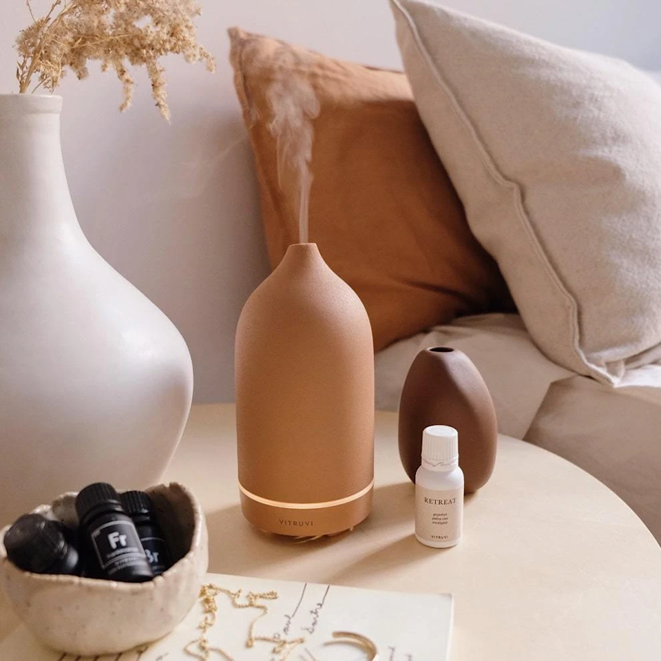 """Jazz up her at-home diffuser situation with this chic terracotta alternative.<br><br><strong>Vitruvi</strong> Stone Diffuser, $, available at <a href=""""https://go.skimresources.com/?id=30283X879131&url=https%3A%2F%2Fvitruvi.com%2Fproducts%2Fessential-oil-diffuser-terracotta"""" rel=""""nofollow noopener"""" target=""""_blank"""" data-ylk=""""slk:Vitruvi"""" class=""""link rapid-noclick-resp"""">Vitruvi</a>"""