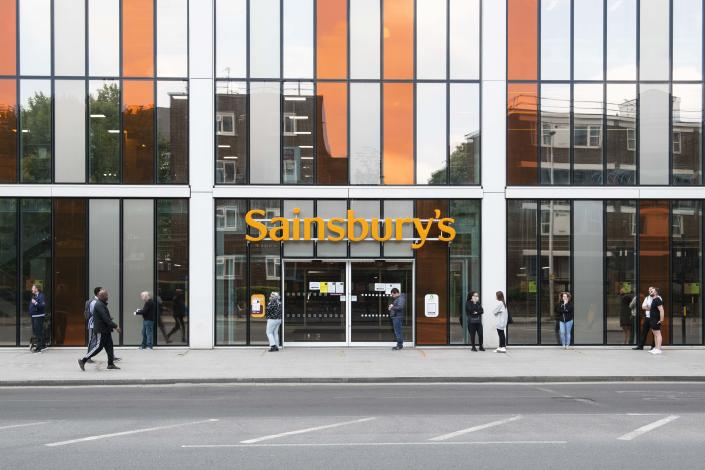 Members of the public respect social distancing rules and queue outside Sainsburys during the Coronavirus outbreak, Vauxhall London. Picture date: Monday 4th May 2020. Photo credit should read: David Jensen/EMPICS Entertainment