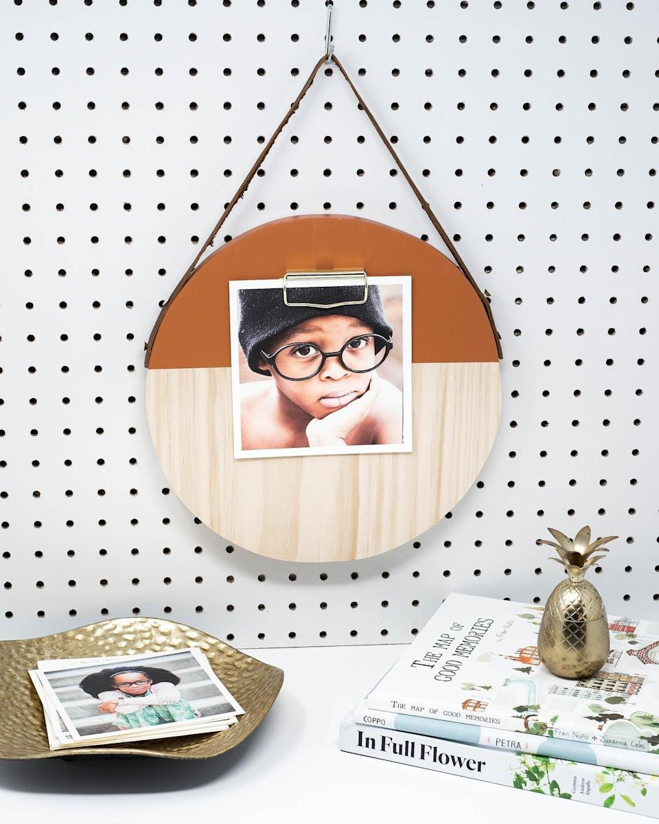 <p>Give them a functional piece like this <span>Orange Round Clipboard</span> ($43) to display their favorite photo, quote or to-do list.</p>
