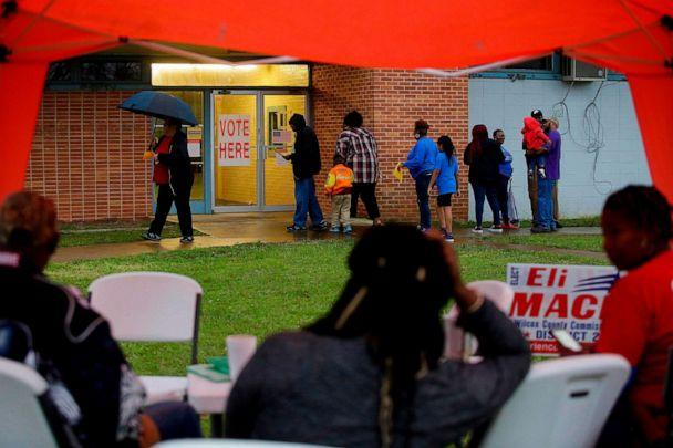 PHOTO: Voters enter a polling station at the National Guard Military Base during the presidential primary in Camden, Ala., on Super Tuesday, March 3, 2020. (Joshua Lott/AFP via Getty Images)