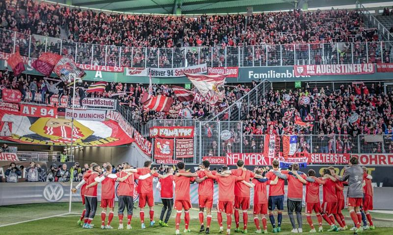 Bayern Munich's players celebrate in front of their fans at the Volkswagen Arena