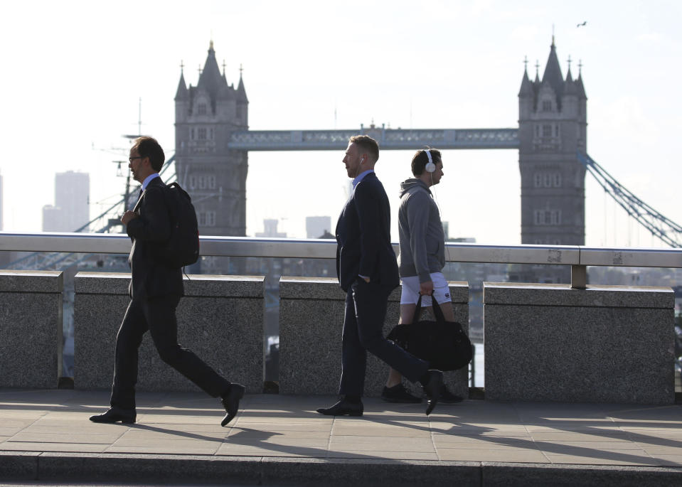 "Commuters cross London Bridge, which has reopened after Saturday evening's terror attack, in London Monday, June 5, 2017. London police have raided two addresses and detained ""a number"" of people suspected of some connection to the Saturday night car attack and knife rampage on London Bridge. (Isabel Infantes/PA via AP)"