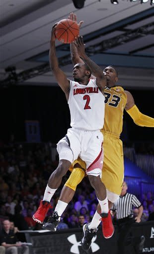 No. 2 Louisville beats No. 13 Missouri 84-61