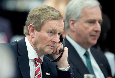 Ireland's Taoiseach (Prime Minister) Enda Kenny (L) listens to speeches at a luncheon hosted by the Chamber of Commerce of Metropolitan Montreal during his visit to Montreal, Quebec, Canada May 4, 2017.  REUTERS/Christinne Muschi