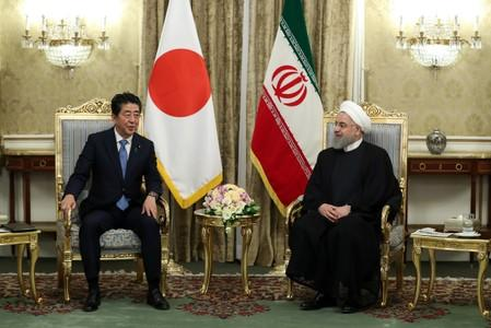 Iranian President Hassan Rouhani meets with Japan's Prime Minister Shinzo Abe, during in Tehran