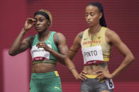 Elaine Thompson-Herah, of Jamaica, prepares for her heat of the women's 100-meters at the 2020 Summer Olympics, Friday, July 30, 2021, in Tokyo. (AP Photo/Matthias Schrader)