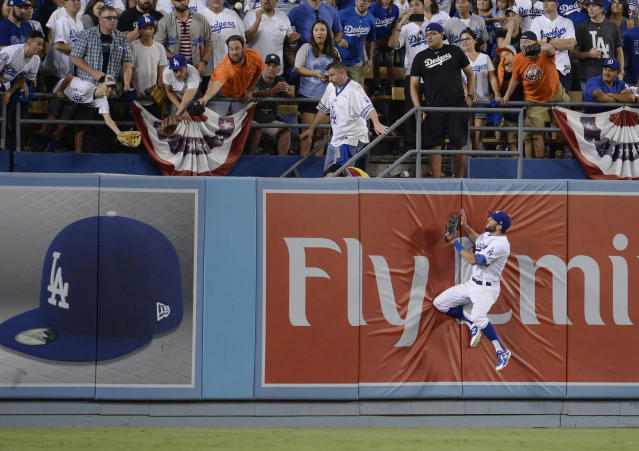<p>Los Angeles Dodgers outfielder Chris Taylor (3) watches a ball hit for a solo home run by Houston Astros left fielder Marwin Gonzalez (not pictured) in the 9th inning in game two of the 2017 World Series at Dodger Stadium. Mandatory Credit: Gary A. Vasquez-USA TODAY Sports </p>