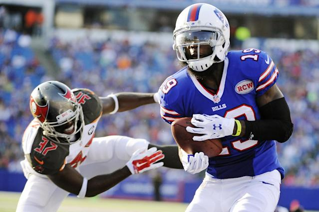 Buffalo Bills wide receiver Mike Williams (19) evades Tampa Bay Buccaneers free safety Keith Tandy (37) to score a touchdown during the second half of a preseason NFL football game Saturday, Aug. 23, 2014, in Orchard Park, N.Y. (AP Photo/Gary Wiepert)