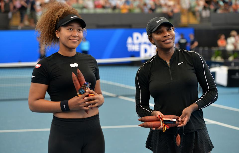 Serena Williams (pictured right) and Naomi Osaka (pictured left) pose for pictures before their women's singles match at the 'A Day at the Drive' exhibition tennis tournament in Adelaide.