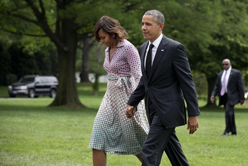 President Barack Obama and first lady Michelle Obama arrive at the White House in Washington, Thursday, May 15, 2014, from a trip to New York City. (AP Photo/Manuel Balce Ceneta)