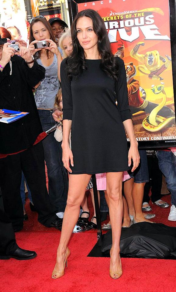 """All eyes were rightfully on Angelina Jolie as the screen siren strutted down the red carpet in a Ralph Lauren black mini and Stuart Weitzman nude peep-toes at the """"Kung Fu Panda"""" DVD release party. Devan/<a href=""""http://www.infdaily.com"""" target=""""new"""">INFDaily.com</a> - November 9, 2008"""