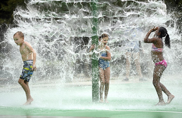 Children splash in the new splash pad at Riverview Park in North Augusta, S.C., Monday, August 12, 2019.Hazardous heat is in the Augusta, Ga., area weather forecast. Forecasters say most of the South from Texas to parts of South Carolina will be under heat advisories and warnings as temperatures will feel as high as 117 degrees.(Michael Holahan/The Augusta Chronicle via AP)