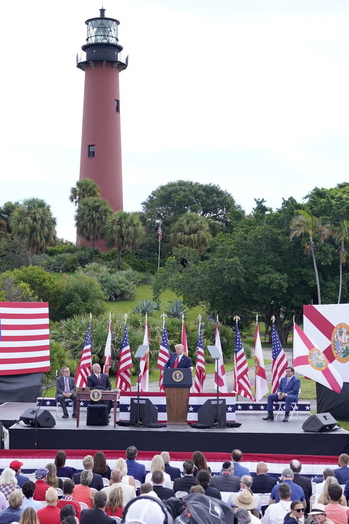 President Donald Trump, center, speaks during an event discussing environmental policies at the Jupiter Inlet Lighthouse and Museum Tuesday, Sept. 8, 2020, in Jupiter, Fla. (AP Photo/John Raoux)