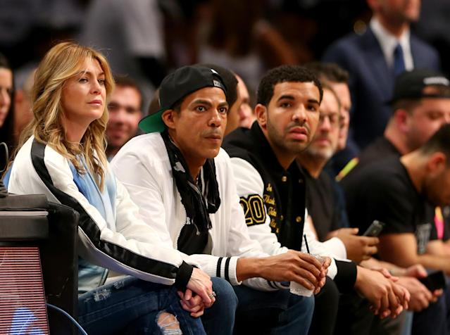 NEW YORK, NY - MAY 02: Ellen Pompeo, Chris Ivery and Drake attend Game Six of the Eastern Conference Quarterfinals during the 2014 NBA Playoffs at the Barclays Center on May 2, 2014 in the Brooklyn borough of New York City. NOTE TO USER: User expressly acknowledges and agrees that, by downloading and/or using this photograph, user is consenting to the terms and conditions of the Getty Images License Agreement. (Photo by Elsa/Getty Images)