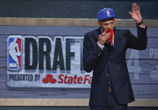Isaiah Austin waves to the crowd after being granted ceremonial first-round pick. (AP)