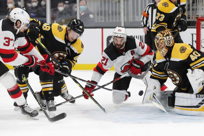 New Jersey Devils' Pavel Zacha (37) scores against Boston Bruins' Tuukka Rask (40) during the third period of an NHL hockey game, Sunday, March 7, 2021, in Boston. (AP Photo/Michael Dwyer)