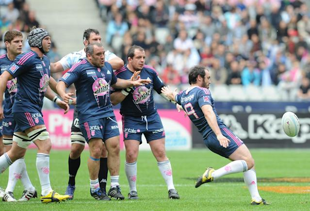 Stade Français' scrum-half Julien Dupuy kicks the ball during the French Top 14 rugby union match Stade Francais vs. Racing Metro on May 5, 2012 at the Charlety stadium in Paris. AFP PHOTO / FRANCK FIFEFRANCK FIFE/AFP/GettyImages