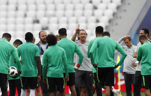 Saudi Arabia head coach Juan Antonio Pizzi, center, gives instructions to his players during the official training session of the Saudi Arabian team on the eve of the group A match between Saudi Arabia and Egypt at the 2018 soccer World Cup in the Volgograd Arena, in Volgograd, Russia, Sunday, June 24, 2018. (AP Photo/Darko Vojinovic)