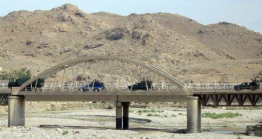 This file photo shows Pakistani army troops driving across a bridge in Miranshah, the main town in North Waziristan, in 2006. A US drone attack has killed at least four militants near Miranshah, according to security officials