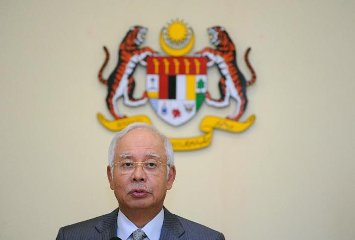 Human Rights Watch says in a report that Prime Minister Najib Razak is accelerating a crackdown that began after a poor showing in the 2013 election (AFP Photo/Mohd Rasfan)