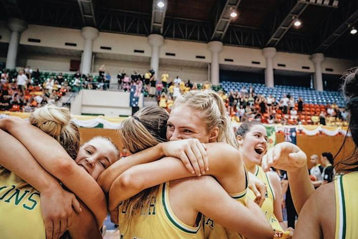 Izzy Anstey (center, hugging Gemma Potter) is one of 16 international student-athletes suing DHS and ICE to get into the country.
