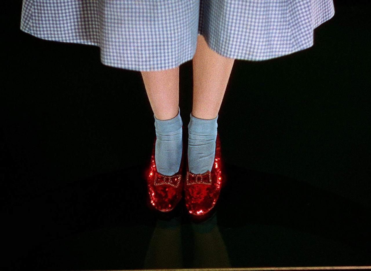 """<p>Dorothy's slippers were <a href=""""https://www.nytimes.com/2018/09/04/us/dorothys-ruby-slippers-stolen.html"""" target=""""_blank"""">originally silver</a>. At least, that is how novelist L. Frank Baum wrote them in his 1900 fantasy, <em><a href=""""https://www.amazon.com/Wonderful-Wizard-Oz-Frank-Baums/dp/1423171268?tag=syn-yahoo-20&ascsubtag=%5Bartid%7C10063.g.34074044%5Bsrc%7Cyahoo-us"""" target=""""_blank"""">The Wonderful Wizard of Oz</a></em>. Film producers favored a glittering bright red, however, for that Technicolor wow.</p>"""