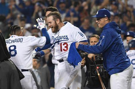 Los Angeles Dodgers first baseman Max Muncy (13) celebrates with teammates after hitting a walk off home run in the 18th inning. (AP)