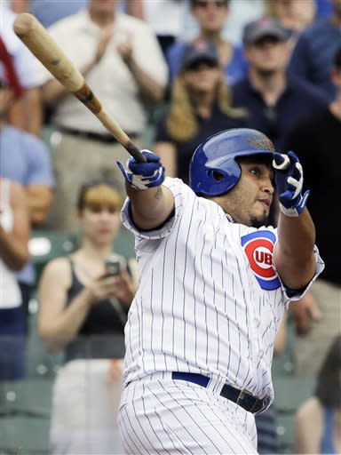 Chicago Cubs' Dioner Navarro hits a sacrifice fly during the 11th inning of a baseball game against the Pittsburgh Pirates in Chicago, Sunday, July 7, 2013. The Cubs won 4-3. (AP Photo/Nam Y. Huh)