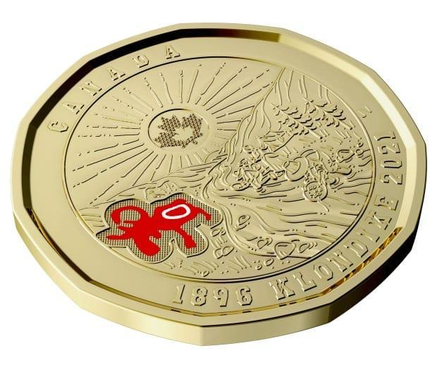 A commemorative $1 coin issued by the Royal Canadian Mint marks the 125th anniversary of the discovery of gold in the Klondike region of Yukon. The Mint consulted with some Yukon First Nations before settling on a design. (Royal Canadian Mint - image credit)