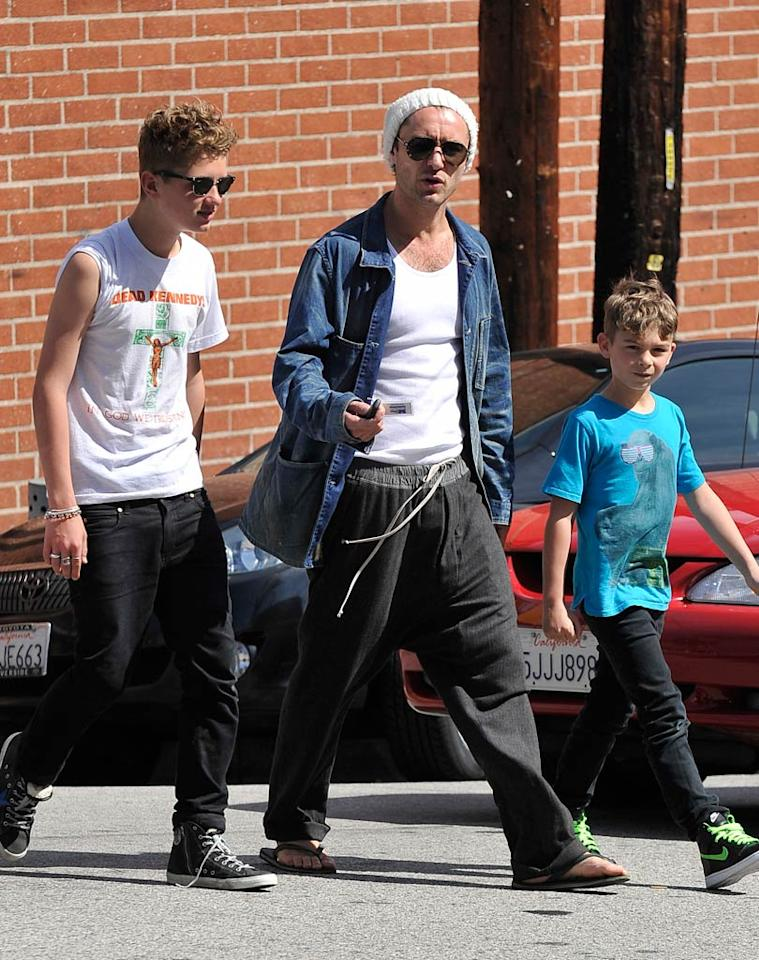 """British actor Jude Law also enjoyed some father-son bonding time with his boys Rafferty, 14, and Rudy, 8, on Tuesday. The trio hit up The Village Idiot in West Hollywood, where they took in a soccer game. Fern/<a href=""""http://www.splashnewsonline.com/"""" target=""""new"""">Splash News</a> - April 5, 2011"""