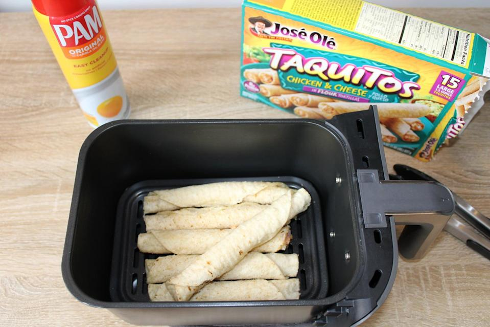 """<p>Place taquitos in the basket of your air fryer. It's best to cook them in a single layer so that they get crispy, but if you're pressed for time and don't mind a softer taquito, you can stack them on top of each other. (I have a <a href=""""http://www.ninjakitchen.com/exclusive-offer/DZ201WBKT/ninja-foodi-6-in-1-8-qt-2-basket-air-fryer-with-dualzone-technology/"""" class=""""link rapid-noclick-resp"""" rel=""""nofollow noopener"""" target=""""_blank"""" data-ylk=""""slk:Ninja two-basket air fryer"""">Ninja two-basket air fryer</a>, which I love for its capacity to cook big batches of food.)</p>"""