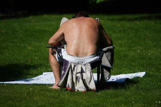 A man sunbathing in St James's Park, London on the hottest day of the year so far. (Photo: Yui Mok - PA Images via Getty Images)